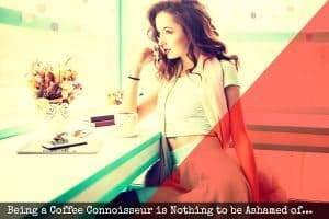 Attractive Female drinking coffee and looking out coffeeshop window