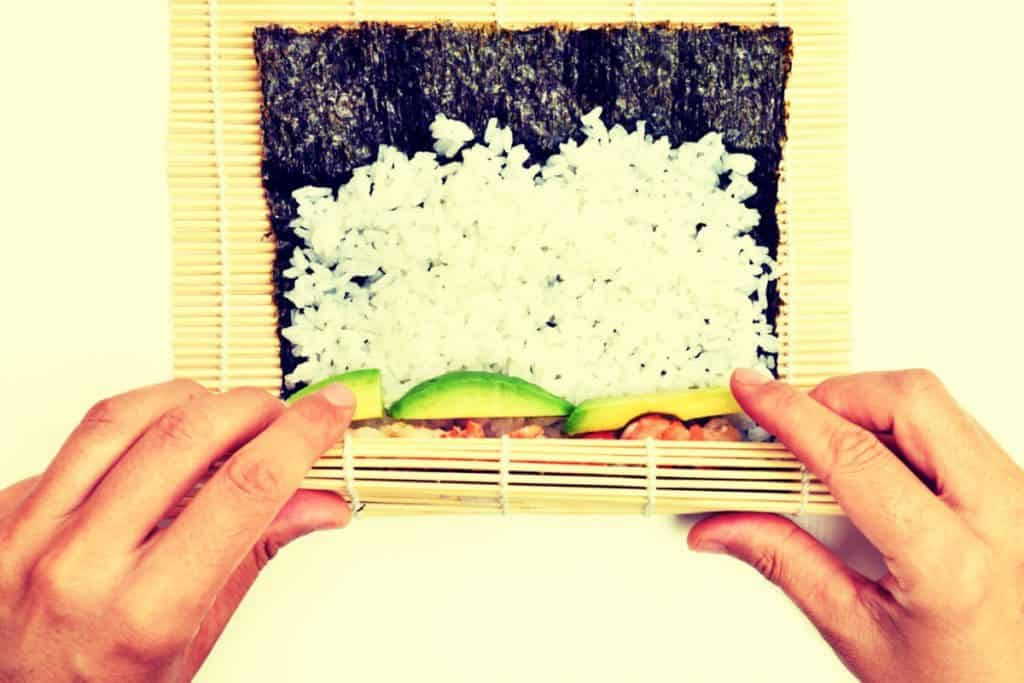 Bamboo Sushi Roller, two hands, rice