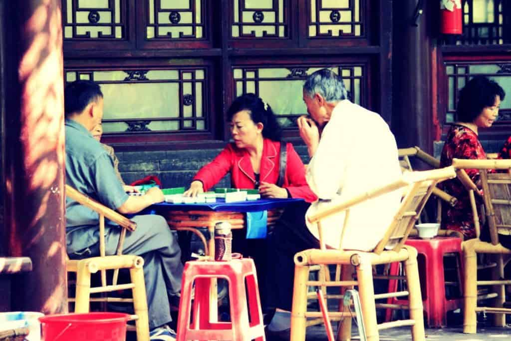 Three People Playing Chinese Mahjong Location Mainland China