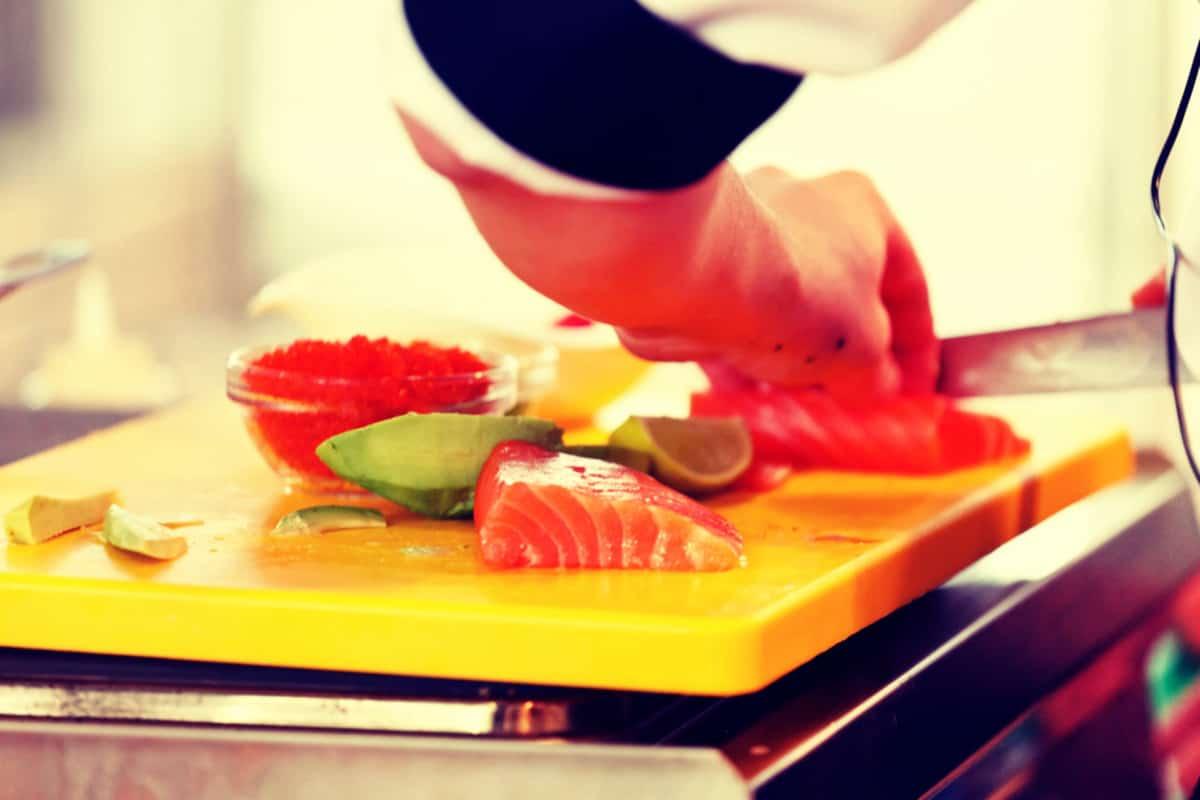 cutting sashimi in kitchen