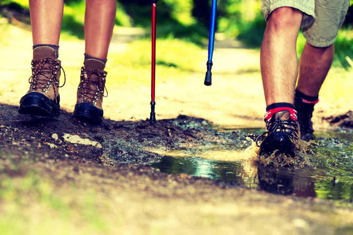 Couple Hiking Mud Puddle Hiking Poles in Use