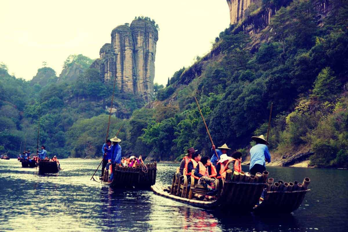 Wuyishan People Rafting in Mountain River on Bamboo Canoe