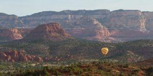Mountains of Sedona and Yellow Hot Air Balloon